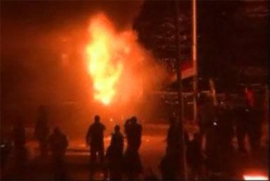 A police van burns on 6th October Bridge